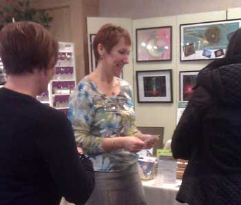 Kristi Borst with her Energy In Form Healing Artwork at a recent spiritual metaphysical expo